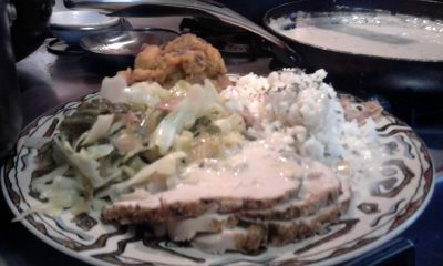 slow roasted boneless turkey breast with sour cream gravy with rice pilaf, savory sauteed cabbage and side of candied yams with apples